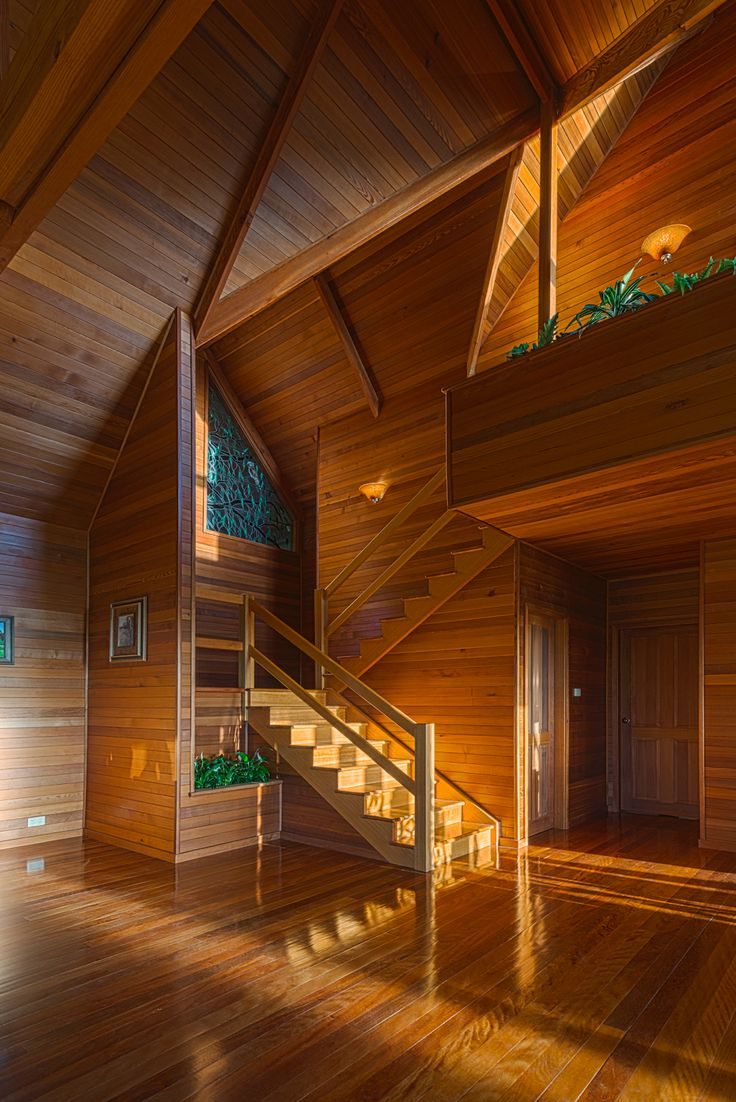 Amazing architecture by Stedman Design, gorgeous photo by Belfry Arcade. The crew were up before sunrise to capture the warm sunlight coming in for this shot. Stained glass by Ron Jensen, over 4kms of Cedar paneling, Tasmanian Oak stairs, and Blackbutt flooring.
