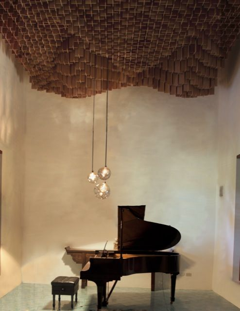 re-menor [d-minor] [d-moll] is an acoustic [ceiling] diffuser designed by pedroyjuana for a Steinway piano hosted in an hacienda on the Yucatan in Southeastern Mexico. The ceiling is made up of roughly 3,000 pieces of Caoba plywood cut at 50 different lengths, forming a porous, diaphanous, and/or not, flimsy, undulating surface.
