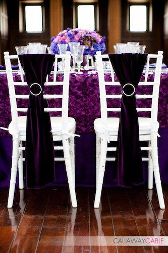 Purple Decorated Chairs for the Wedding Reception wedding reception decor his & hers chairs