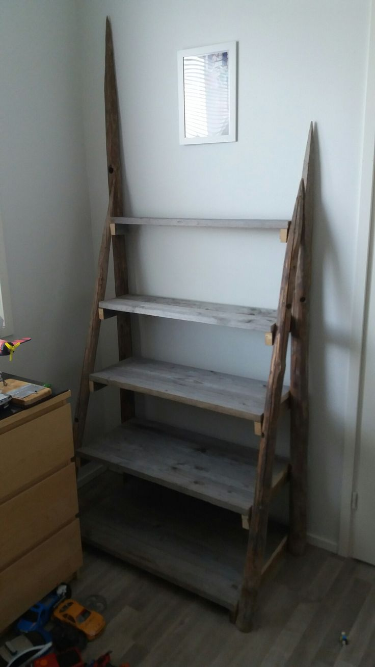 I made this rustic looking shelf from hay poles and salvaged pallet wood for my son's legos.