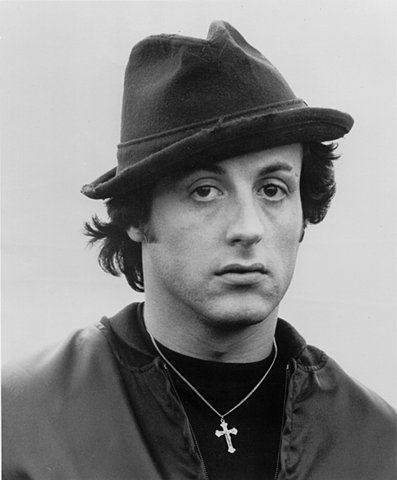 Here's Sylvester Stallone starring in the movie Rocky as the legendary fictional boxer. He's consistently seen wearing his linen fedora throughout the film which was shot in Philadelphia.