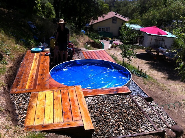 THE CABIN HOUSE - Great blog and there's a post about stock tank pools