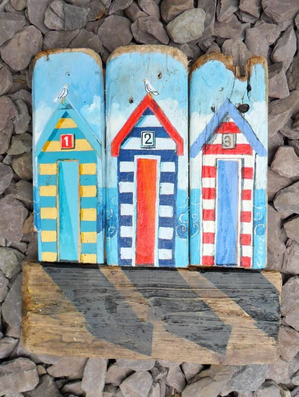 'three beach huts' - driftwood art -by Lizzie Spikes
