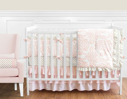 Amelia 9 pc Crib Bedding set has all that your little bundle of joy will need. Let the little one in your home settle down to sleep in this incredible nursery set. This baby girl bedding set features a delicate damask and a coordinating metallic polka dot. This collection uses the stylish colors of blush pink, gold and white. The design uses 100% cotton fabrics that are machine washable for easy care. This wonderful set will fit all cribs and toddler beds.