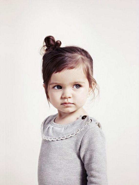 Adorable bangs and bun on toddler girl's short hair. I wonder if this would look cute on Avery