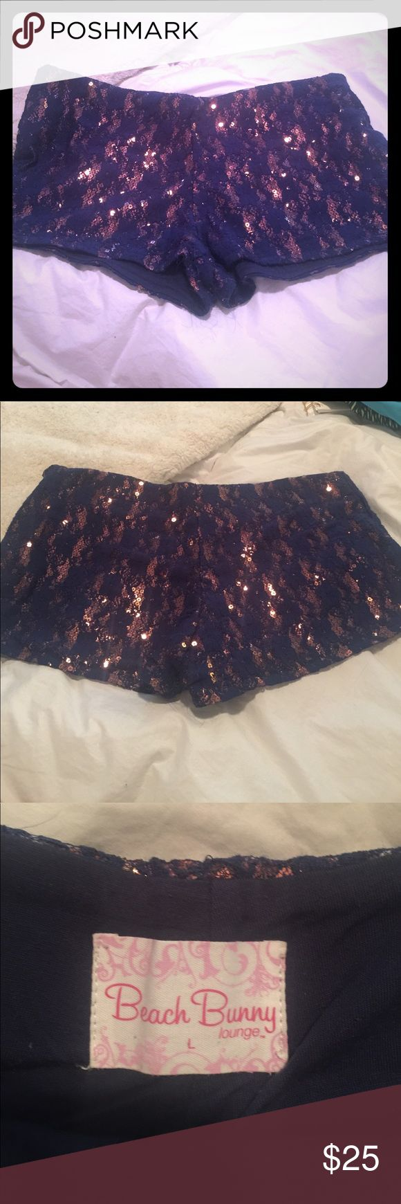 Beach Bunny Sparkly shorts! Gently used. Cute navy blue and rose gold sparkly shorts. Washed once and some fringe started on bottom mid area but overall great shorts! Size Large which could fit a medium too. Beach Bunny Shorts