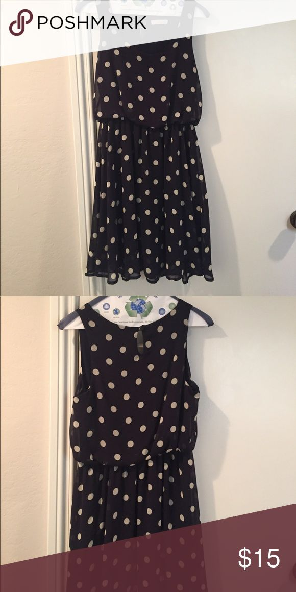 Navy Blue Polka Dot Dress Navy party dress with off white polka dots! Cute hem to the skirt, perfect for parties, I used to wear it out swing dancing! Falls a little above the knee on me and I'm 5'3'' Lush Dresses