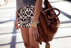 leather bag, batik pattern shorts, stacked gold