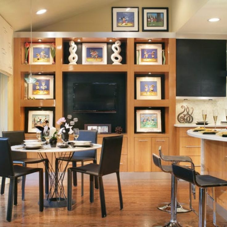 A Matte Black Kitchen Makes A Bold Statement In This: Black Kitchen Cabinets: Make A Bold Statement [23