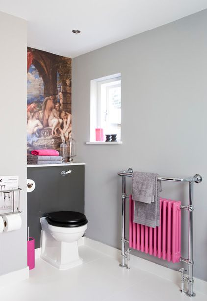 Get in the pink Grey and pink is a magical pairing, especially when the pink is neon, as it is here. If you want a bold look, a pink radiator will bring that in spades. To amp up the drama even more, echo the colour around the room in bathroom accessories, such as towels and candles.