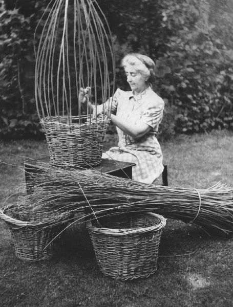 Basket making, Mrs Francis Willmott at basket making centre under the auspices of the West Sussex Federation of Women's Institutes. Aim is to produce 2 million potato baskets – countrywide -for years crop. 1943.