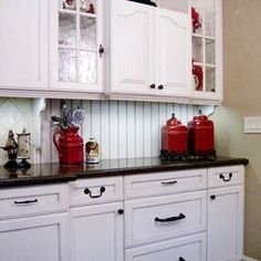 white cabinets, grey counter tops with red accents