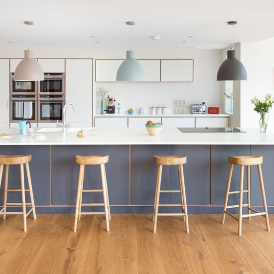 This huge island unit has room to house a ceramic hob, double sink and still has tons of space for kids to sit and have their breakfast or do homework. Love the trio of pendants too. http://www.housetohome.co.uk/articles/9-standout-kitchen-islands_532978.html