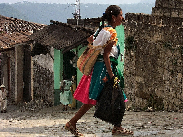 A Nahua Indian woman walking in the small town of Cuetzalan. Cuetzalan is located in the state of Puebla in Mexico.