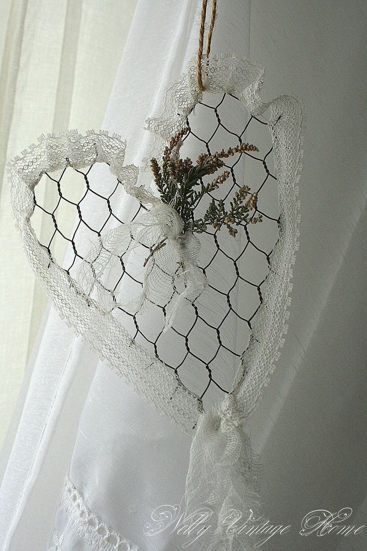 """Chicken wire heart, trimmed out in lace with sprigs of dried flowers - this one is just snipped out, but I would cut wire and form the outline of the heart, then twist the ends of the chicken wire around it to stabilize, and cut down on sharp points. Can do other shapes as well, but hearts are great.... [from """"nelly vintage home"""" ]-"""
