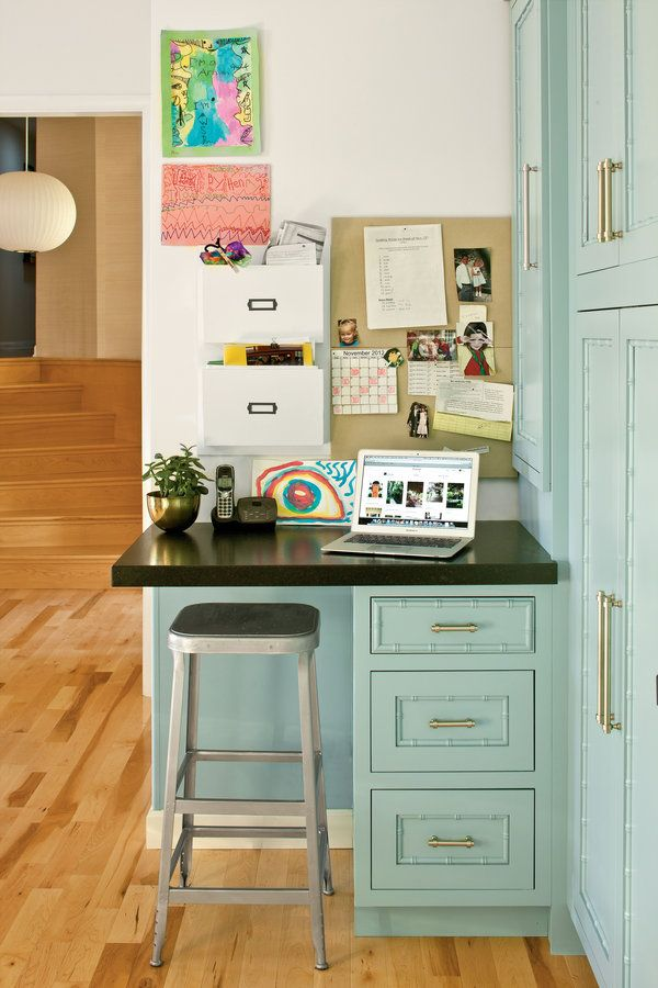 A sliver of space—only 30 inches wide—is all you may need to carve out a space in your kitchen for your laptop and the kids' paperwork.