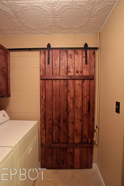 #KatieSheaDesign ♡ ❥ DIY Sliding barn door for under $100!!! I found this post after doing a lot of research. Just to buy pre-made sliding hardware is hundreds of dollars, which didn't include the door. This is an amazing replica for cheap. Absolutely doing this!!