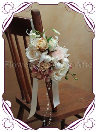 Vintage coloured silk flower pew decoration for hire in Melbourne