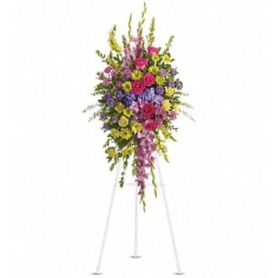 . A lovely assortment of flowers such as lavender gladioli and cushion spray chrysanthemums, yellow snapdragons, carnations and daisy spray chrysanthemums, hot pink roses, purple hydrangea, asters and assorted greens are all presented on an easel.