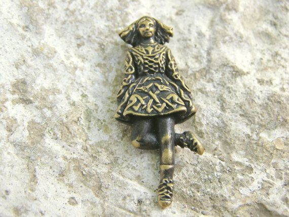 Irish dancer women pendant is a thoughtful, personalized gift for anyone who enjoys Lord of the dance and #Ireland in whole. Such a unique dancing girl! You'll get complimen... #handmade #etsy #castbrass #brasspendant #charm #fairyinwoods #celtic #ireland