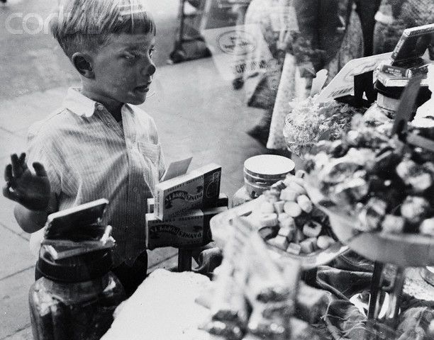 Little Boy Looking Into a Candy Shop