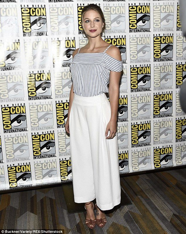 Putting her best foot forward! Supergirl's Melissa Benoist looked lovely in an off-the-shoulder top and high-waisted trousers as she arrived for her panel