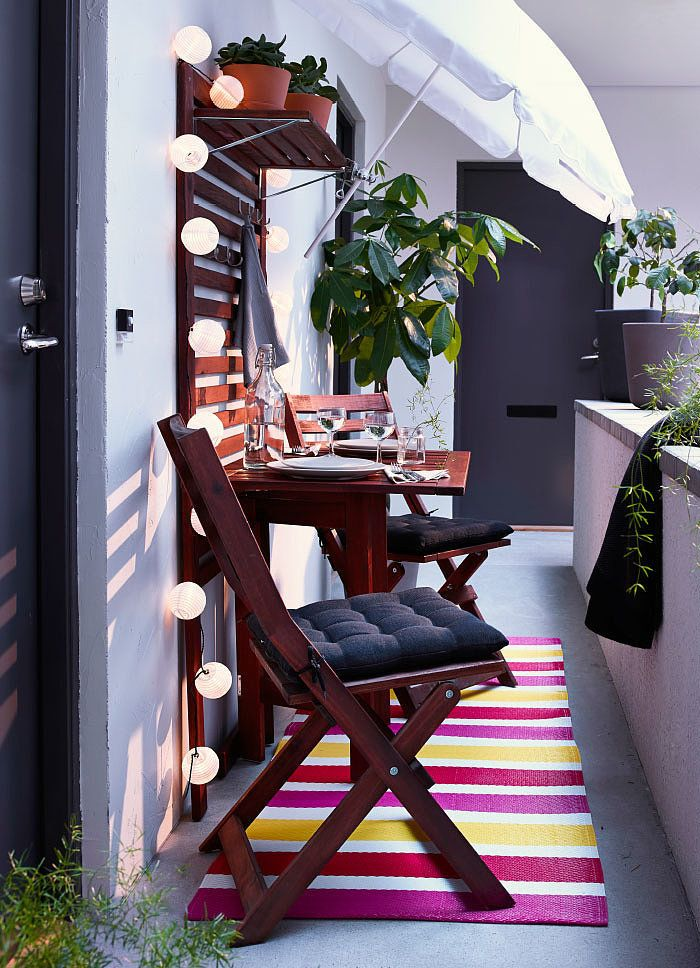 Playful string lights, a striped colorful rug, and Ikea furniture