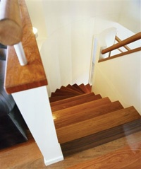 Stairs with Grey Ironbark flooring and handrail. Curved spiral staircase