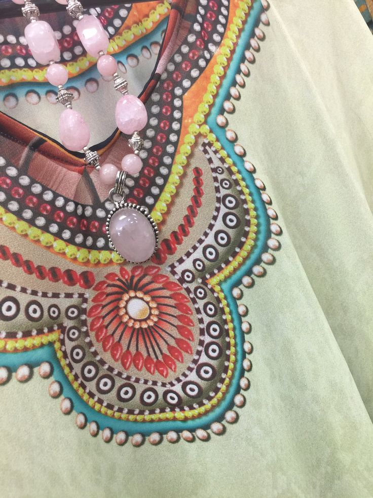 Give up yourself for the party with a Pink Color Pendant set is studded with Stones and there is a beautiful Floral design surrounding it. There is a string (Mala) faux beads.