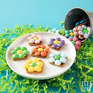 Melted chocolate adheres colorful candy flowers to pretzel pieces for a pretty bake sale-ready dessert.
