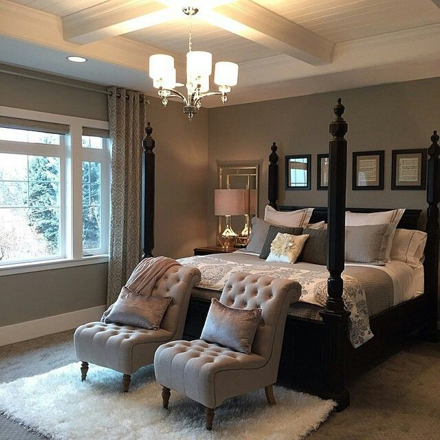 we love every detail of this beautiful bedroom designed by chairs at the foot of the bed