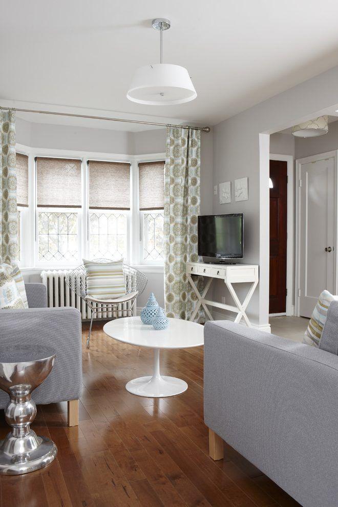 Bay window treatments living room transitional with gray sofa gray wall