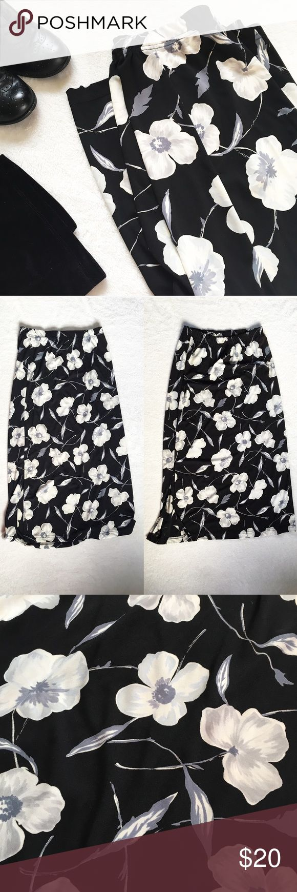 """Vintage 90s Floral High Waist Grunge Skirt 🌸 Vintage 90s High Waisted Floral Skirt by Stephanie Parks  🌸 Has a pattern of gray and white flowers and leaves on a black background, shown in 3rd photo  🌸 Loose fitting   🌸 Has an elastic waistband  🌸 Has a 13"""" slit on each side of the skirt  🌸 Size medium   Measurements: Waist: 28""""  Hips: 38"""" Length: 34.5""""  Keywords: 90's, 1990s style, high-waist, high waisted, high waist, mid waist, 90s grunge, 90's grunge, grungey, witchy, witch, wiccan…"""