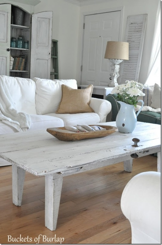 barn door coffee table    Might need to result to turning my old historic door headboard into a cool coffee table...
