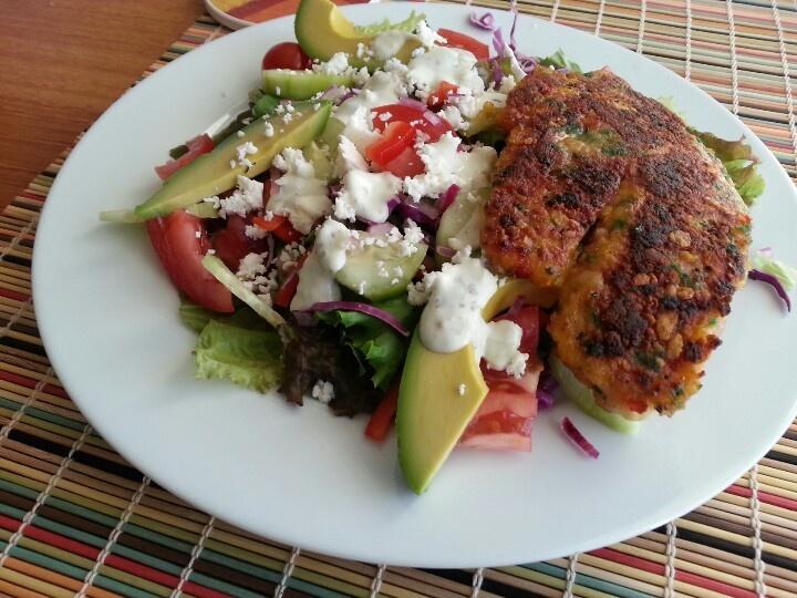 Tortilla encrusted tilapia, cojita cheese, purple onion, purple cabbage, avacado, and salsa verde dressing.