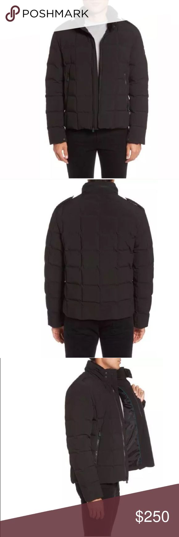 """$325 TUMI DOWN FILLED BOX QUILTED JACKET NEW WITH TAGS $325  TUMI DOWN FILLED BOX QUILTED JACKET MENS SIZE XL   Size Info True to size. Considered a Trim fit; fitted through the chest, armholes and sides.  Cozy, box-quilted synthetic fill warms a water-resistant jacket equipped with a stowaway hood and inset ribbed collar for complete comfort and protection from top to bottom. 26 1/2"""" length (size Medium) Front zip closure Front zip pockets; interior zip pockets Lined 92% polyester, 8%…"""