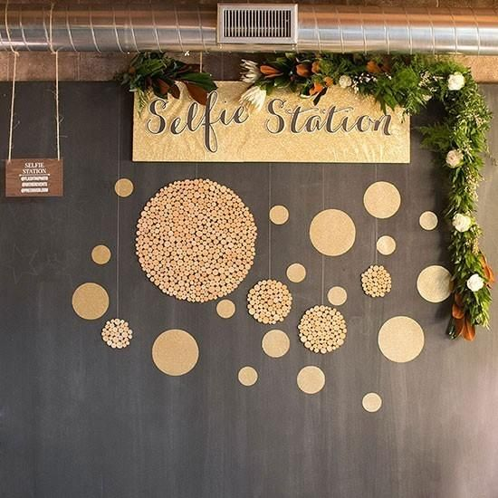 geometric black and gold selfie station with greenery and flowers @myweddingdotcom