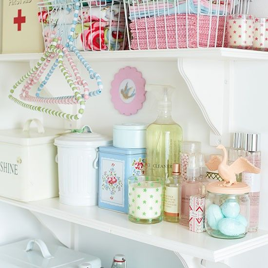Use wall hung shelving in the utility room for added storage space. Add pastel coloured tins and jars for a pretty vintage look.