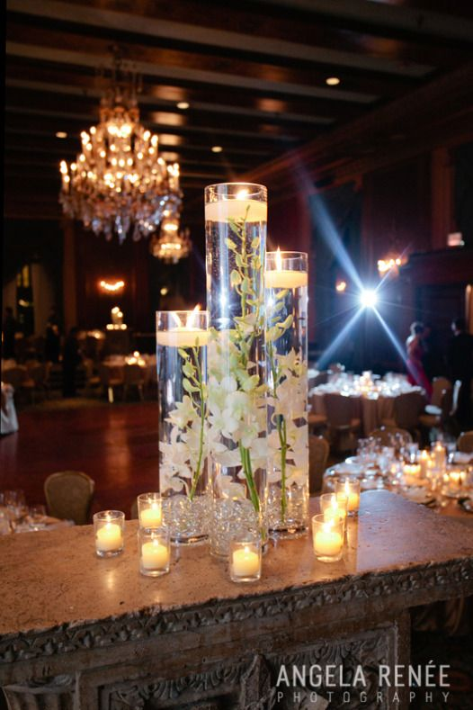 Submerged orchid centerpieces. Reminds me of my wedding day. :)