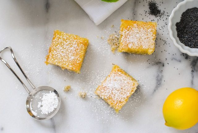 Meyer Lemon Bars with Poppyseed Crust - A flaky poppyseed crust topped with tart and sweet Meyer lemon filling.