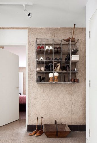 wallmounted wire racks give this shoe storage a modern industrial feel