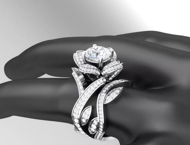Gorgeous lab created diamond Rose engagement ring, with pave' all around both bands. Leaf detail all around. A very special bridal set.  1.33 ctw center ston