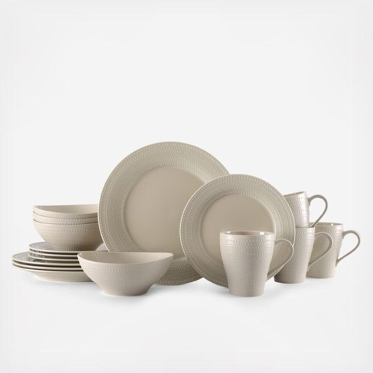 Ryder Beige brings transitional style to your tabletop, combining traditional and contemporary shapes for a timeless look. Simple beige pieces are adorned with a subtle yet striking beaded line pattern that forms bands of varying widths around each piece. Crafted of earthenware. Microwave and dishwasher safe. 16 piece dinnerware set, service for four, includes (4) each: 11 inch dinner plate, 8-1/2 inch salad plate, 7 inch (24 ounce) cereal bowl and 18 ounce mug.