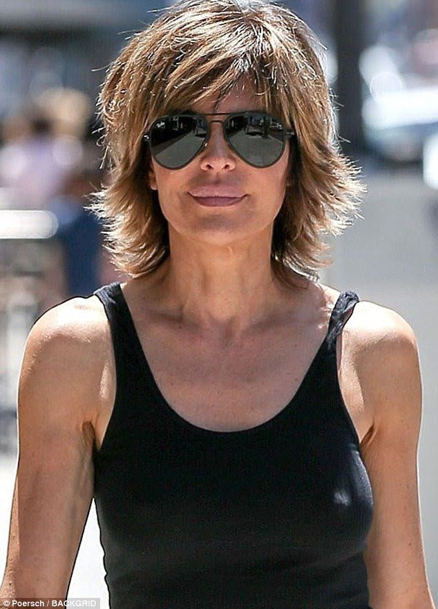 Lisa Rinna wears vest and ripped jeans in Beverly Hills