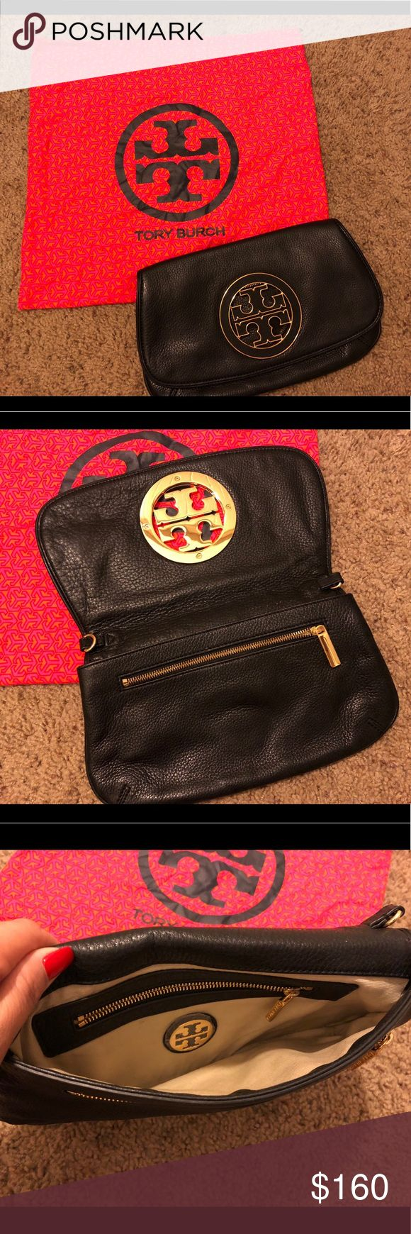 """Tory Burch Amanda Logo Clutch Clutch is in great condition only used a couple times.   Defined by a clean, versatile shape, this Tory Burch Amanda Crossbody is the very definition of smart style. Designed in pebbled leather and a large medallion on the flap , this crossbody stores on-the-go essentials.   Features pebbled leather Imported Made of pebbled leather. Approx. 11 1/2"""" x 8"""" x 1 1/2"""". Long strap for shoulder or crossbody wear. Magnetic closure. Interior zip pocket. Fabric lining…"""