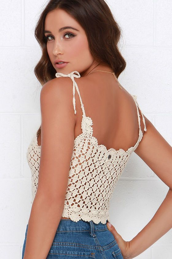 Light, airy, and oh-so-cute are definitely attributes of the Billabong Dream Lover Cream Crochet Crop Top! Cotton crochet is expertly made into adjustable, tying straps above a scalloped scoop neckline. An open crochet pattern leaves sheer details along the bodice before ending in a cropped, scalloped hem. Unlined and sheer. 100% Cotton. Hand Wash Cold.