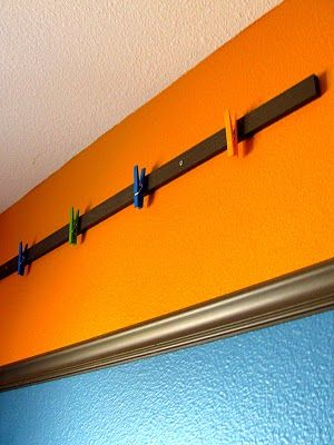 Displaying kids' art (from IHeartOrganizing). Think I want to buy some clothespegs and make this...
