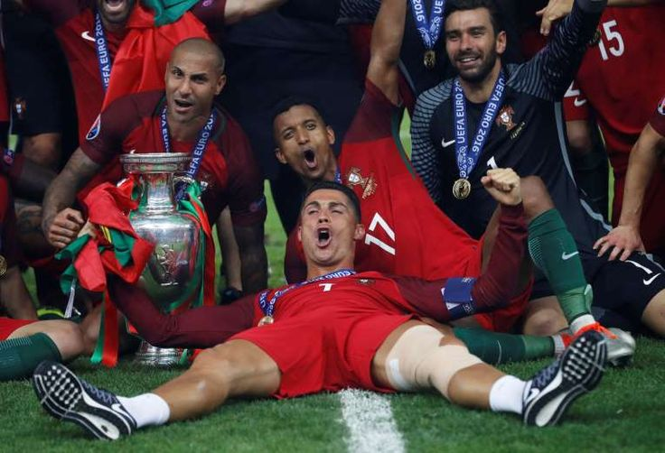 Portugal's Cristiano Ronaldo celebrates with Ricardo Quaresma, Nani, Rui Patricio and the trophy after winning Euro 2016 against France July 10, 2016.