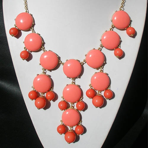 J.Crew Bubble necklaces this one in Coral. Look for these on ebay. Great selection of colors and you can usually get for less than $25.00