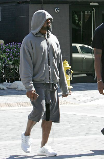c96a05073aa88 ultra boost adidas triple white  kanye west strolling around wearinh haider  ackermann grey zip hoofie yeezy shorts and adidas ultrabo